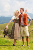 Bavarian couple in fashionable leather pants and dirndl — Stock Photo