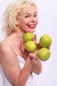 Woman offers to apples — Stock Photo