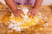 Hands kneading a dough — Stock Photo