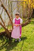 Girl in the dirndl is bored with coloured ones wobble in the hand — Stock Photo