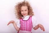Small Bavarian girl in the dirndl in pose — Stock Photo