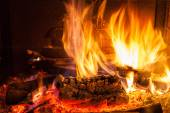 Burning billets in fireplace — Stock Photo