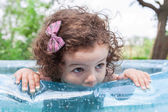 Baby girl in inflatable pool — Foto de Stock