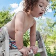 Baby girl standing on ladder — Stock Photo #77979404