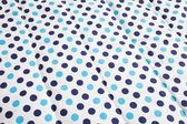 Light blue and dark blue polka dotted quilt — Stock Photo