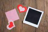 Instant photo with blank note and hearts — Stock Photo