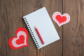 Notebook with hearts and pencil — Stock Photo
