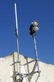 Antenna and lighthouse — Stock Photo