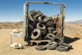Old tires in a dumpster. — Foto de Stock