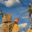 Husband and wife climbing team on the summit. — Stock Photo #57094983