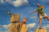 Husband and wife climbing team on the summit. — Stock Photo