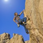 Climber on a steep wall. — Stock Photo #80415626