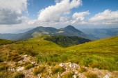 Summer landscape in mountains and the dark blue sky with clouds — Stock Photo