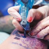 Process of creating a tattoo — Stock Photo