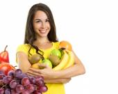 Beautiful young happy woman with fruits — Stock Photo
