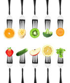 Fruits and vegetables on the forks — Stock Photo