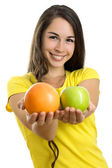 Young happy woman with fruits — Stock Photo