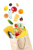 Grocery bag and falling healthy food — Stock Photo