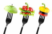 Fruit and vegetable slices on fork — Stock Photo