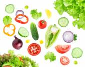 Mixed falling vegetables — Stock Photo