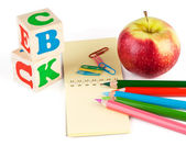 School supplies and apple — Stock Photo