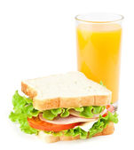 Sandwich and juice — Stock Photo