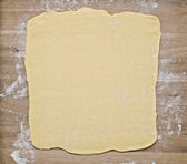 Puff pastry dough on baking board — Stock Photo