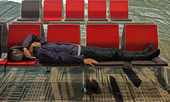 Weary traveller napping due to jet lag — Stok fotoğraf