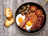 Rustic full english breakfast — Stock Photo