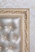 Leather interior in antique carved frame — Stock Photo