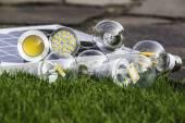 Various bulbs E27, GU10  and solar panel on the grass — Foto Stock