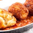 Gooey macaroni and cheese balls with marinara sauce — Stock Photo #57424649