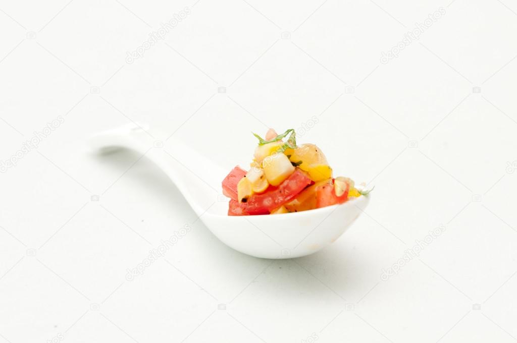 Heirloom tomato salsa with corn and basil, an amuse bouche