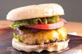 Bacon cheeseburger with coleslaw — Stock Photo