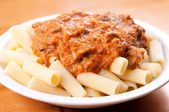 Beef short rib rigatoni with heirloom tomato sauxe and cheese — Stock Photo