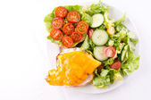 A healthy lunch of salad with a grilled chicken and cheese burge — Stock Photo