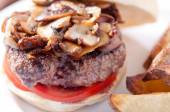 Grilled sirloin hamburger with mushrooms — Stock Photo