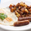 Eggs, sausage and home fries breakfast — Stock Photo #82800316