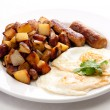 Eggs, sausage and home fries breakfast — Stock Photo #84301370