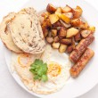 Eggs, sausage and home fries breakfast — Stock Photo #84301570