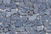 Seamless black ashlar old stone wall texture — Stock Photo