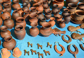 Sale of pottery at fair of national creativity — Стоковое фото