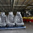 Постер, плакат: Automobile chairs in packing stand in assembly shop of automobil