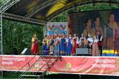 Performance of the Russian national folklore ensemble at fair of — Stock Photo