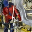 Постер, плакат: Welding of a body of the car device of spot contact welding Aut