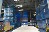 The packed boxes in a modern factory warehouse — Stock Photo