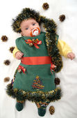 The baby in a New Year's suit of a fir-tree on a white backgroun — Stock Photo