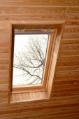 Window on a penthouse of the wooden house — Stock Photo
