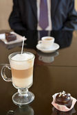 Latte coffee in a glass glass, a cup with coffee of espresso and — Stockfoto