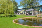 Landscaping with a reservoir and arbors tents — Stock Photo